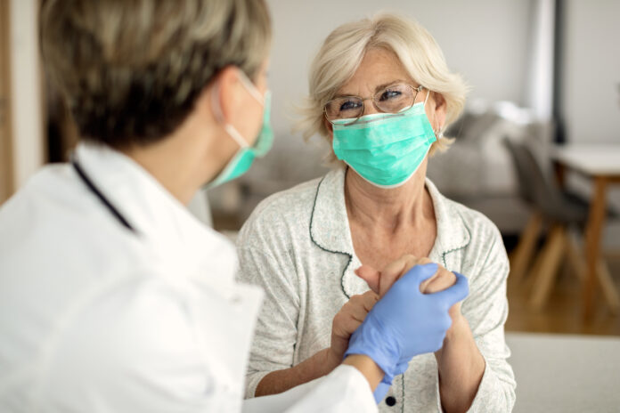 Doctor and female senior citizen talking